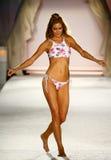 A model walks runway in designer swim apparel during the Frankies Bikinis fashion show. MIAMI, FL - JULY 18: A model walks runway in designer swim apparel during stock image