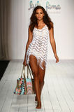 A model walks runway in designer swim apparel during the Luli Fama Swimwear fashion show. MIAMI, FL - JULY 18: A model walks runway in designer swim apparel Stock Images