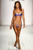 A model walks runway in designer swim apparel during the Luli Fama Swimwear fashion show Royalty Free Stock Image