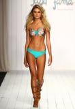 A model walks runway in designer swim apparel during the Luli Fama Swimwear fashion show Stock Image