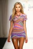 A model walks runway in designer swim apparel during the Luli Fama Swimwear fashion show Stock Images