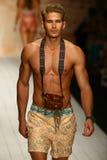A model walks runway in designer swim apparel during the Maaji Swimwear fashion show Royalty Free Stock Photos