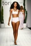 A model walks runway in designer swim apparel during the Tori Praver Swimwear fashion show Royalty Free Stock Photography