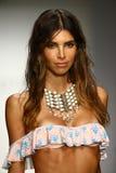 Model walks runway in designer swim apparel during the Tori Praver Swimwear fashion show Royalty Free Stock Photography