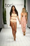 Model walks runway in designer swim apparel during the Tori Praver Swimwear fashion show Royalty Free Stock Photos