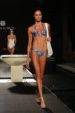 A model walks runway in designers swim apparel for the Sinesia Karol fashion presentation Royalty Free Stock Photography