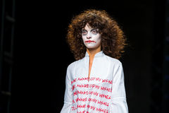 A model walks the runway disguised as the Joker for the Brain and Beast collection Royalty Free Stock Images