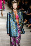 A model walks the runway during the Dries Van Noten show. PARIS, FRANCE - SEPTEMBER 30: A model walks the runway during the Dries Van Noten show as part of the Royalty Free Stock Photography