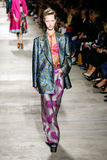 A model walks the runway during the Dries Van Noten show. PARIS, FRANCE - SEPTEMBER 30: A model walks the runway during the Dries Van Noten show as part of the royalty free stock image