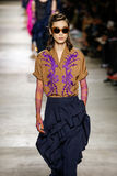 A model walks the runway during the Dries Van Noten show Royalty Free Stock Photography