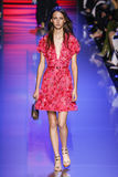 A model walks the runway during the Elie Saab show Stock Images