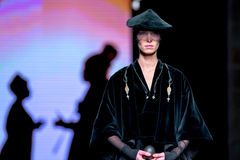 A model walks the runway for the Escorpion collection at the 080 Barcelona Stock Images