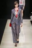 A model walks the runway during the Giorgio Armani fashion show Stock Photos