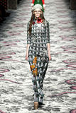 A model walks the runway during the Gucci show Stock Photography