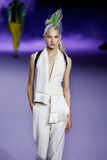 A model walks the runway during the Haider Ackermann show Royalty Free Stock Photo