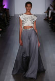 A model walks runway at Hayley Paige fashion show during Fall 2015 Bridal Collection. NEW YORK, NY - OCTOBER 10: A model walks runway at Hayley Paige fashion Stock Images