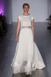 A model walks runway at Hayley Paige fashion show during Fall 2015 Bridal Collection Stock Photos