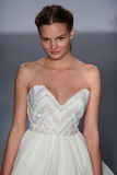 A model walks runway at Hayley Paige fashion show during Fall 2015 Bridal Collection Stock Photo