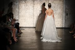 A Model walks the runway for Inbal Dror Bridal show Fall/Winter 2018 Collection. NEW YORK - OCTOBER 5: A model walks the runway for Inbal Dror Bridal show Fall/ royalty free stock image