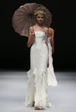 A model walks runway at Ivy and Aster fashion show during Fall 2015 Bridal Collection Stock Images
