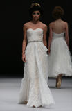 A model walks runway at Ivy and Aster fashion show during Fall 2015 Bridal Collection Stock Photo