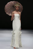 A model walks runway at Ivy and Aster fashion show during Fall 2015 Bridal Collection Stock Image
