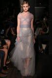 A model walks runway at Johanna Johnson runway Show during Fall 2015 Bridal Collection Stock Image