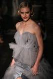 A model walks runway at Johanna Johnson runway Show during Fall 2015 Bridal Collection Stock Photos