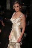 A model walks runway at Johanna Johnson runway Show during Fall 2015 Bridal Collection Stock Images