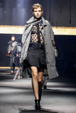A model walks the runway during the Lanvin show. PARIS, FRANCE - OCTOBER 01: A model walks the runway during the Lanvin show as part of the Paris Fashion Week Stock Image