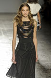 A model walks the runway during the Les Copains fashion show Stock Photography