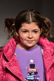 A model walks runway at Little Miss Matched Fall/Winter 2016 Runway Show during petiteParade Royalty Free Stock Images
