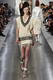 A model walks the runway during the Maison Margiela show. PARIS, FRANCE - SEPTEMBER 30: A model walks the runway during the Maison Margiela show as part of the Stock Photo