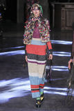 A model walks the runway during the Manish Arora show Stock Image
