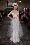 A model walks the runway at the Mira Zwillinger Spring 2015 Bridal collection show Stock Photos