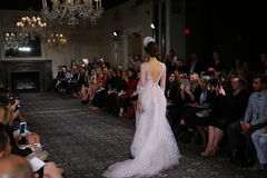 A model walks the runway at the Mira Zwillinger Spring 2015 Bridal collection show