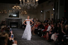 A model walks the runway at the Mira Zwillinger Spring 2015 Bridal collection show Stock Image