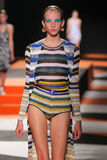 A model walks the runway during the Missoni show Stock Photos