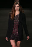A model walks the runway at the Monique Lhuillier fashion show during MBFW Fall 2015 Stock Photo