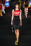 A model walks the runway during the Moschino show Stock Photography