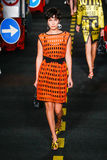 A model walks the runway during the Moschino show Stock Photo