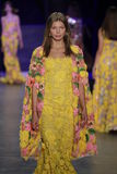 A model walks the runway during the Naeem Khan fashion show Stock Photos