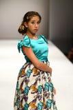 A model walks the runway at the Nancy Vuu fashion show Stock Photography