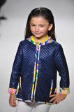 A model walks the runway during the Oil & Water preview at petitePARADE / Kids Fashion Week Stock Image