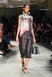 A model walks the runway during the Prada fashion show Stock Photos