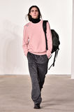 A model walks the runway at Tim Coppens fashion show during the New York Fashion Week Men's Fall/Winter 2016 Royalty Free Stock Photo
