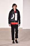 A model walks the runway at Tim Coppens fashion show during the New York Fashion Week Men's Fall/Winter 2016. NEW YORK, NY - FEBRUARY 03: A model walks the royalty free stock photography