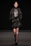 Model walks the runway at the Vivienne Tam fashion show during Mercedes-Benz Fashion Week Fall 2015. NEW YORK, NY - FEBRUARY 16: Model walks the runway at the royalty free stock photography