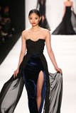 A model walks the runway in a Walter Mendez design at the Art Hearts Fashion show during MBFW Fall 2015. NEW YORK, NY - FEBRUARY 19: A model walks the runway in Stock Photography
