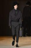 A model walks the runway wearing Robert Geller Stock Photos